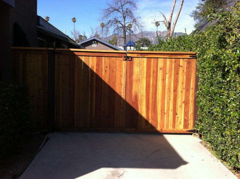 Redwood trim & cap style double gate using a clear natural stain
