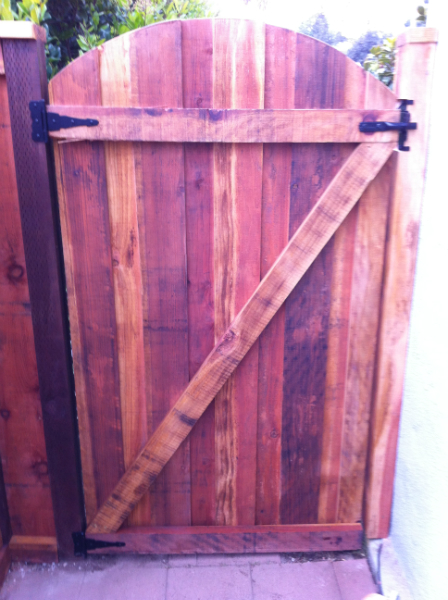 Arched Redwood style gate using black hardware