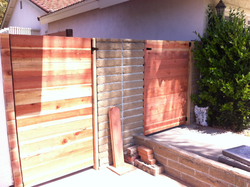 Two contempory Redwood horizontal style gates