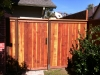 Redwood trim & cap style gate with a clear natural stain