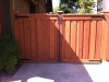 Redwood trim & cap style double gate with a clear natural stain