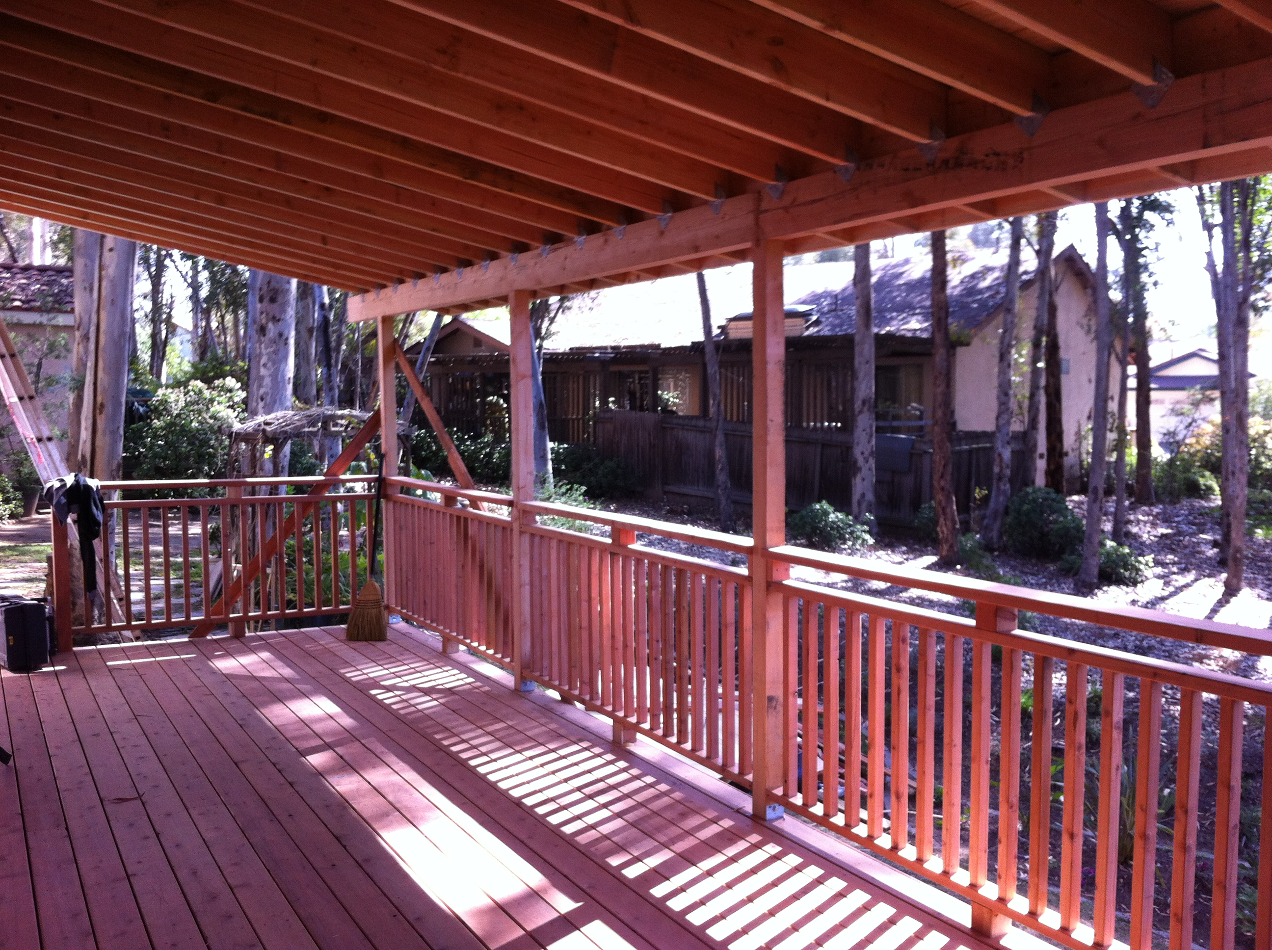 Redwood deck with roof overhang