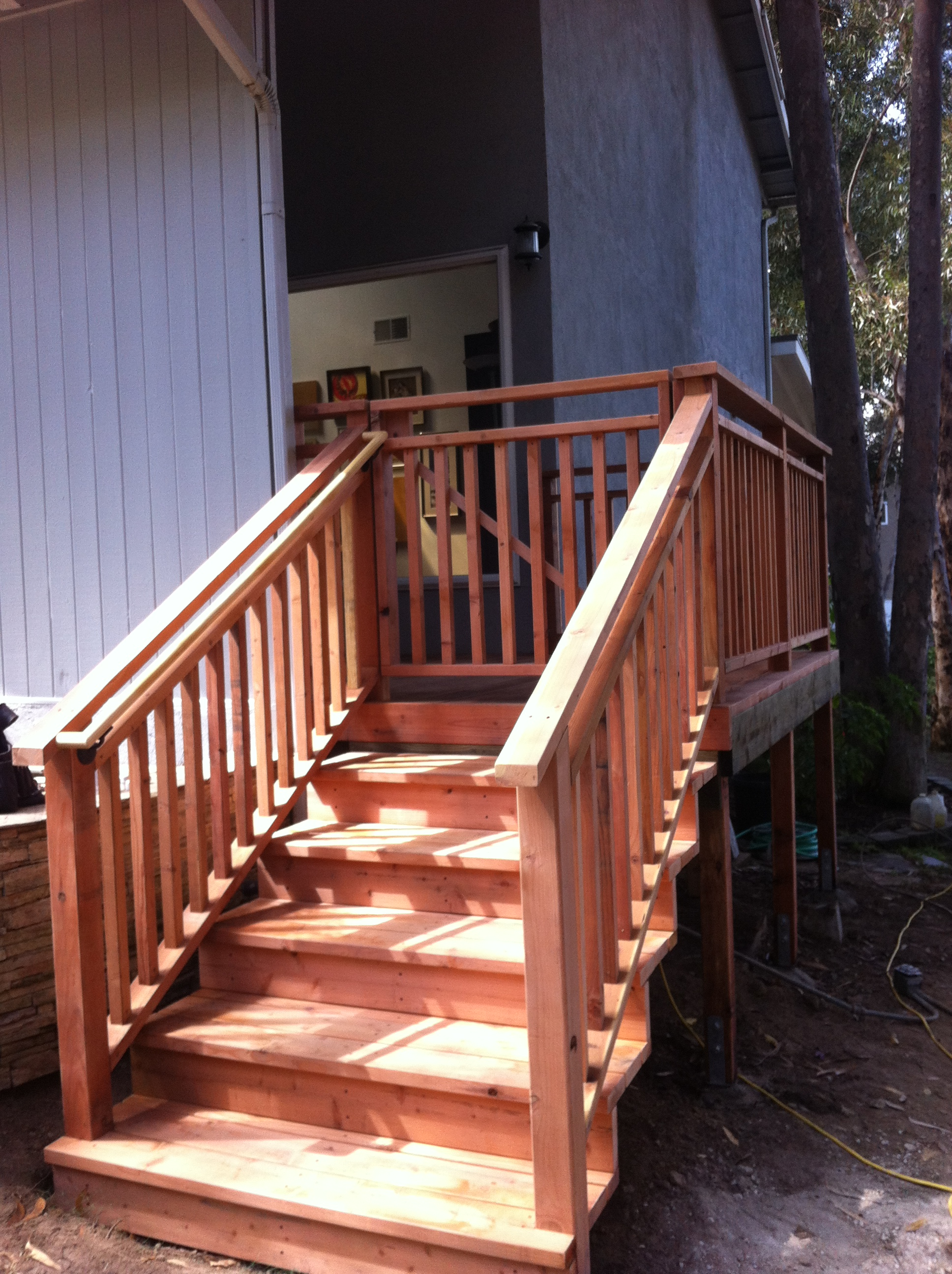 Redwood stairs with handrail
