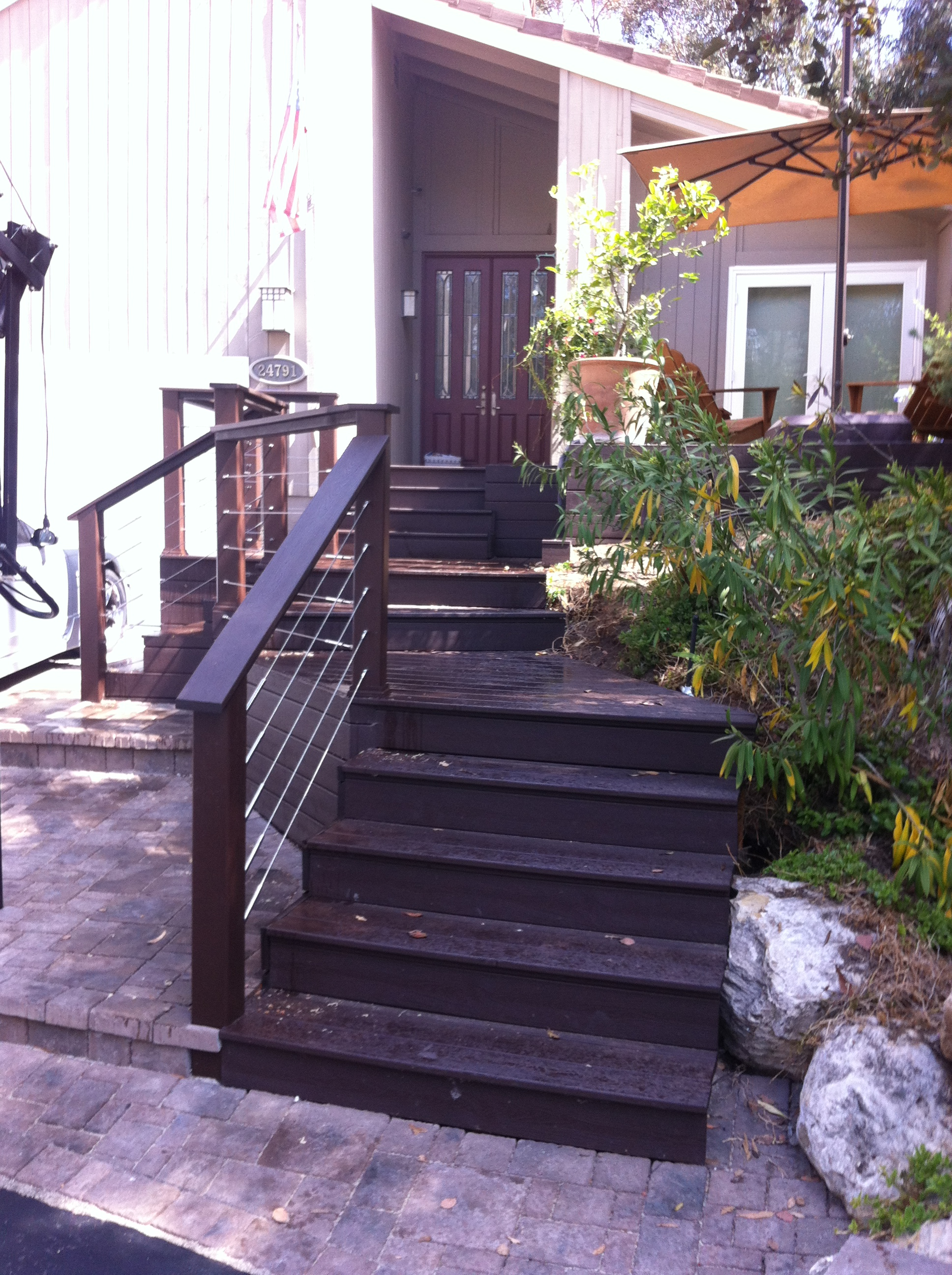 Composite deck with stainless steel cable rail