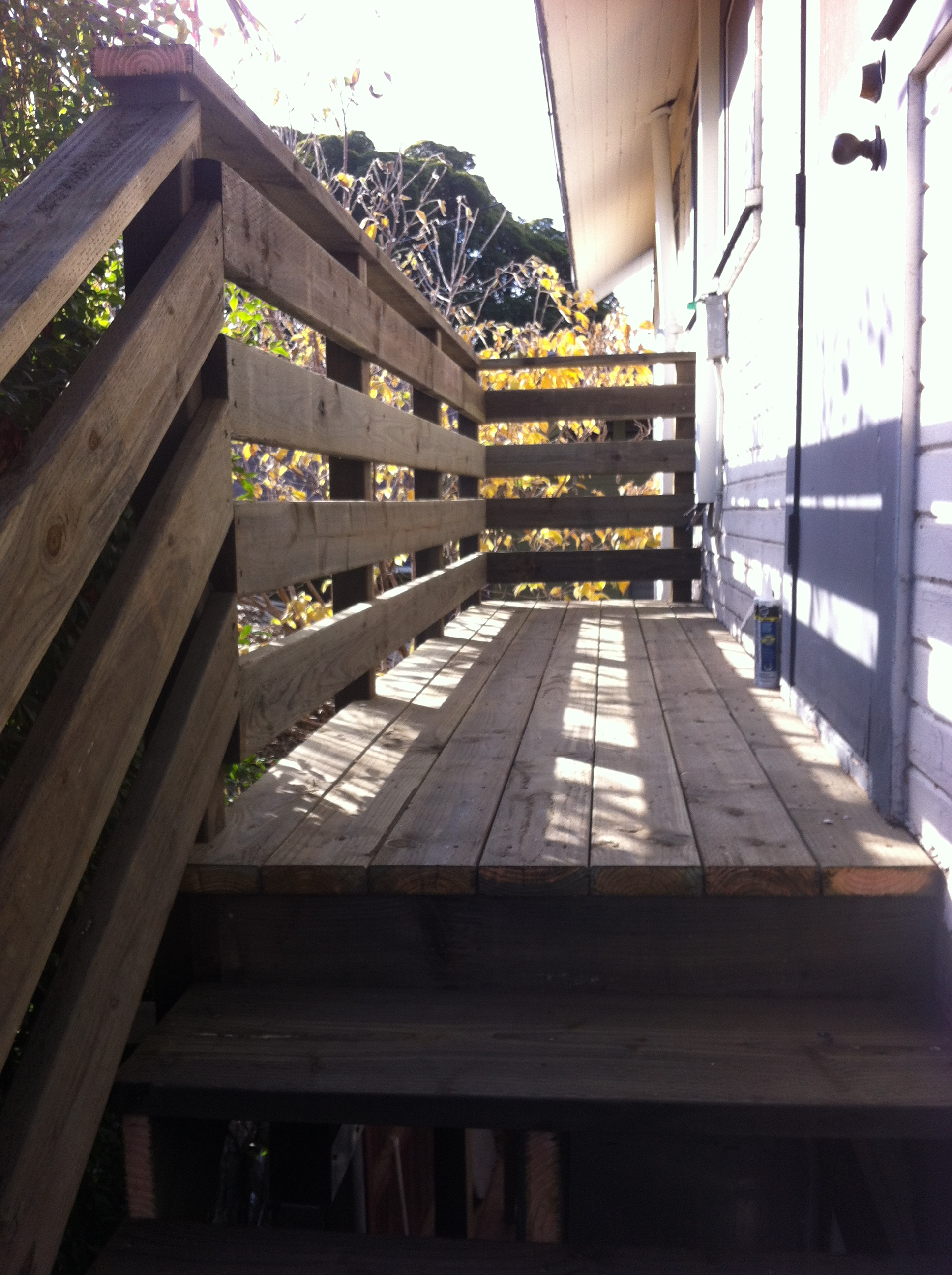 Pressure treated deck with guardrail