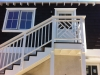 Painted redwood stairs with handrail