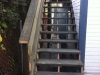 Pressure treated stairs with handrail
