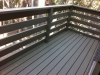 Second story deck finished with solid paint