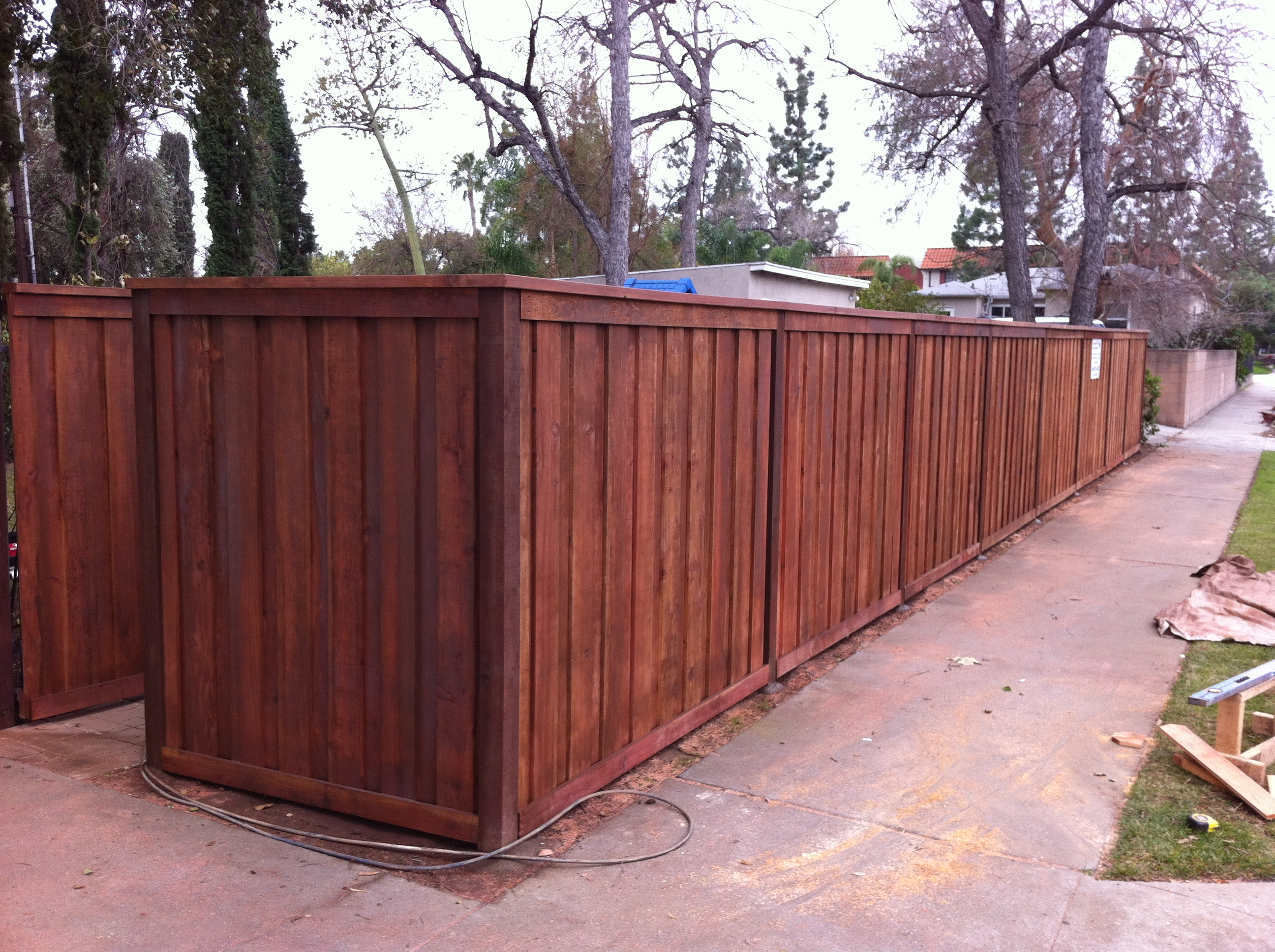 Stained Redwood board on board fence