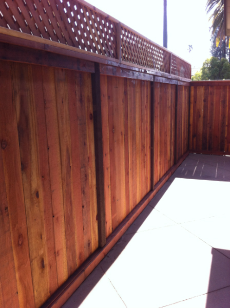 Redwood trim & cap fence with a 1' trellis