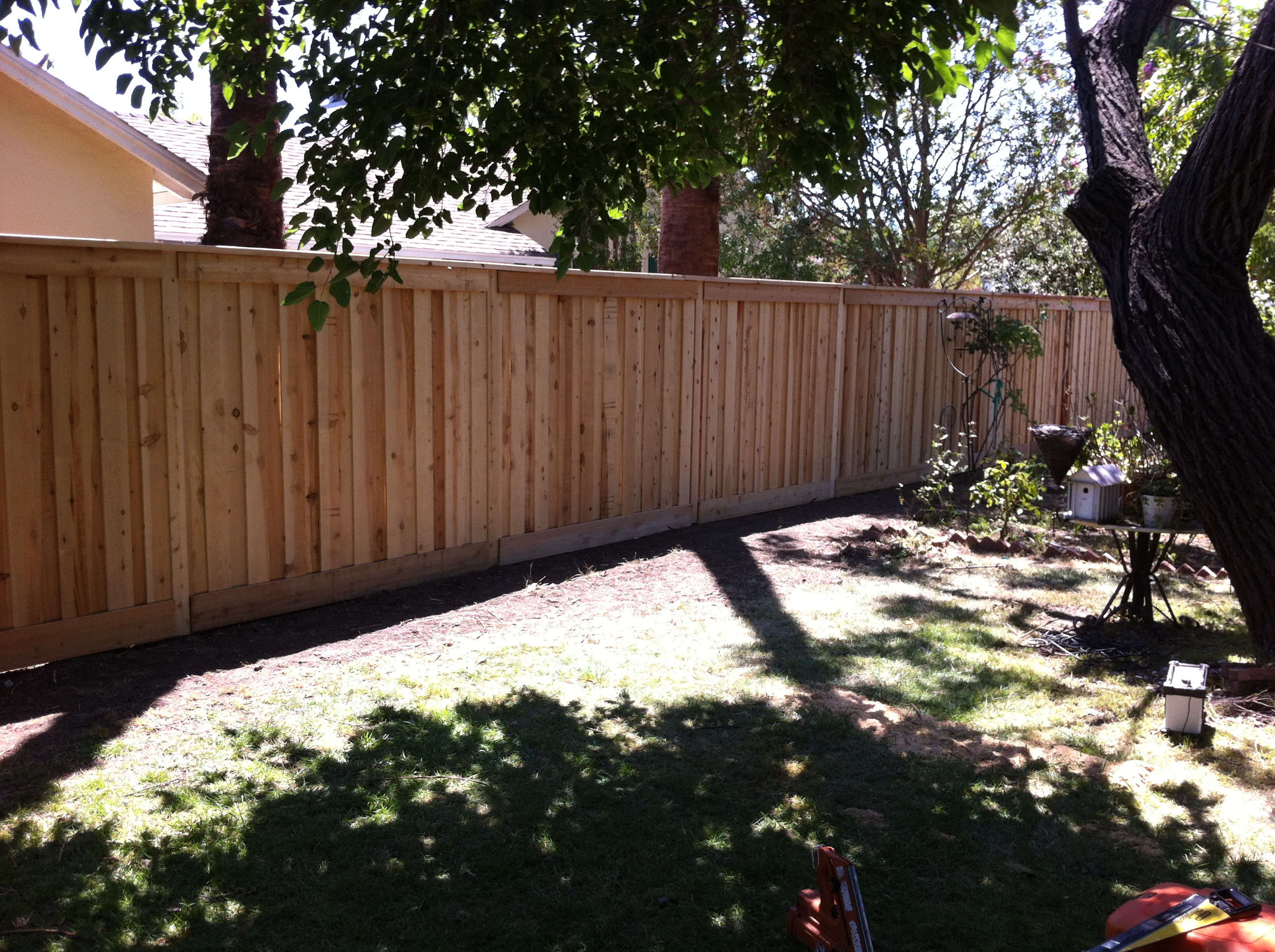 Cedar trim and cap style fence